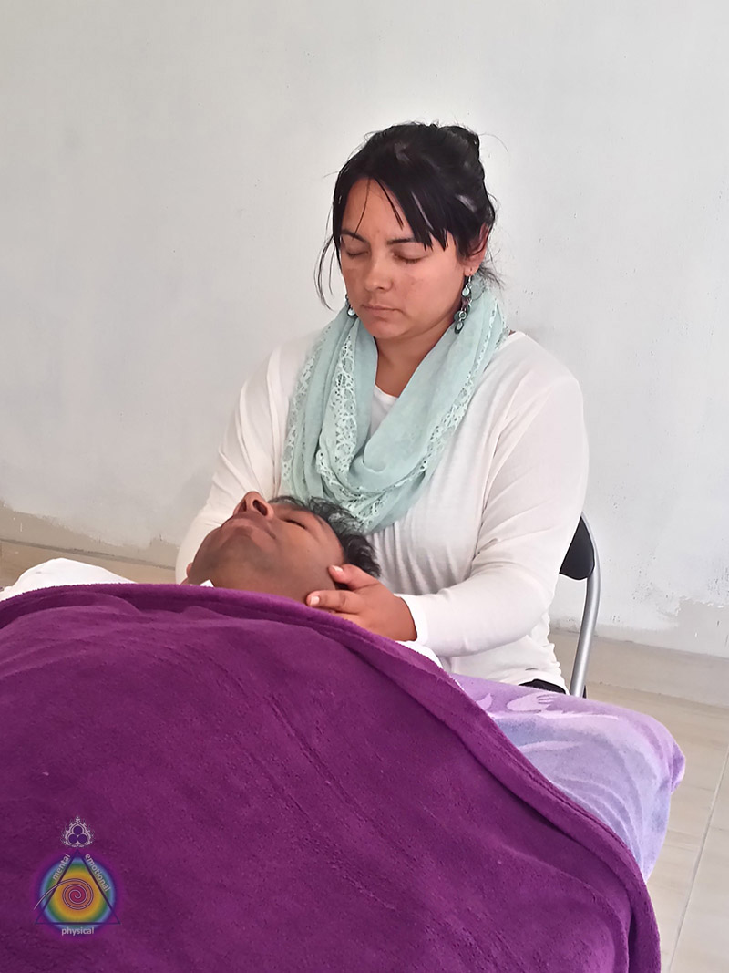 Nadia performing her Reiki assessment