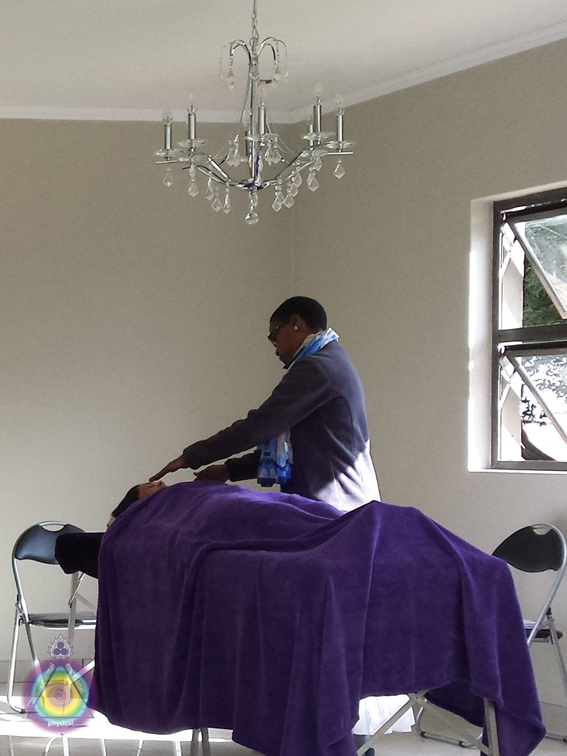 Sherol performing her Reiki assessment