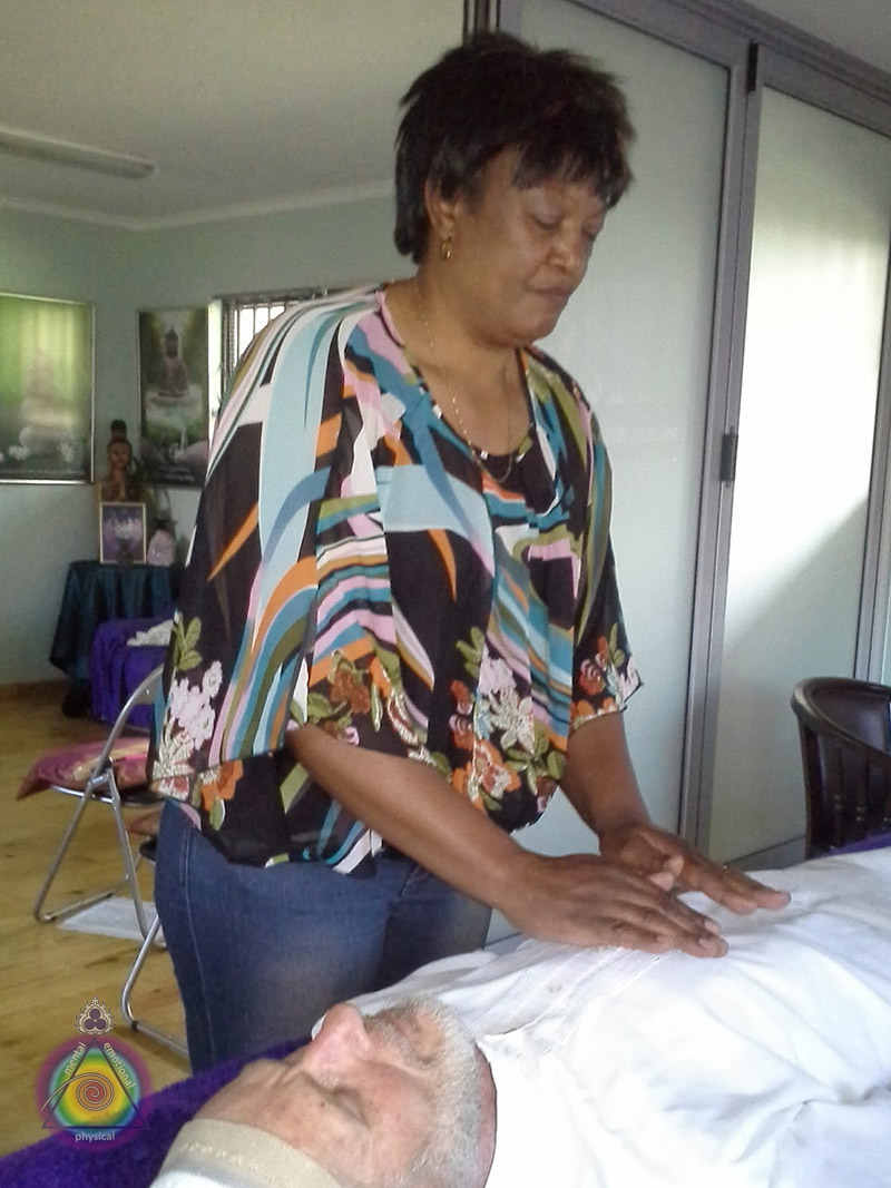 Thoedora performing her Reiki assessment